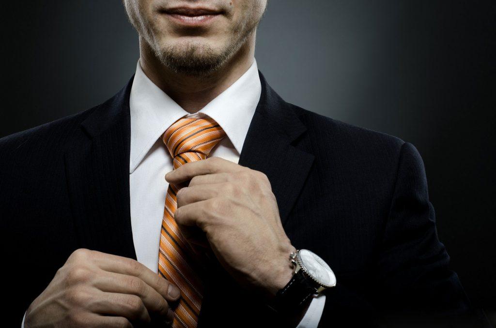 Businessman in black costume tie ones necktie